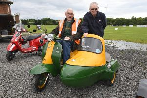 Three-day scooter rally and Sleaford Rugby Club. L-R David Brown of Lincoln with his 1959 Lambretta, Roy Workman of Sleaford. EMN-190617-105554001