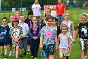 Pupils and staff at Sherard Primary School take part in their fundraising 'Sparkle Walk' in memory of former teacher, Lynda Spargo, who recently passed away EMN-190626-131021001