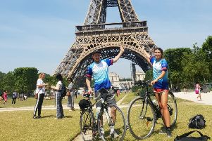 Holly Jones, with boyfriend Conor Turner, pictured at the Eiffel Tower in Paris after completing a fundraising cycle from London Bridge EMN-190628-125355001