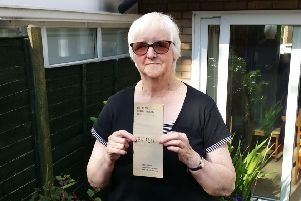 Marilyn Pepper, chair of The Melton Musical Theatre Company, with a programme from the group's first show in 1920 and some photos showing past productions EMN-190724-164558001