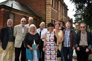 Former students from King Edward VII Upper School reunite 50 years later outside the entrance to the former school EMN-190731-120534001