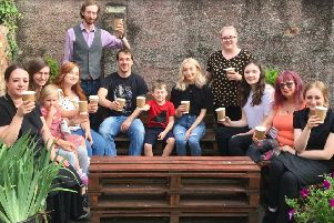 Some of the staff and investors in the garden at More Coffee, in Market Place, Melton EMN-190508-103849001