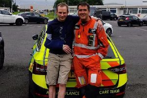 Richard Kershaw with Dr Leon Roberts, of Derbyshire Leicestershire and Rutland Air Ambulance EMN-190829-103850001