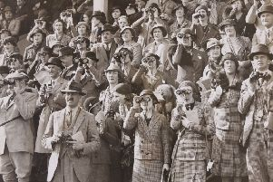 A photograph from a new Melton Carnegie Museum exhibition on horseracing in the Melton area showing the crowd watching a steeplechase EMN-190829-134458001