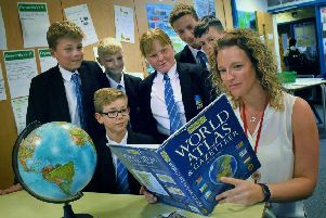 Long Field Academy teacher, Jenny Turner, Melton's first 'climate change teacher', goes over some points with pupils EMN-190309-154257001