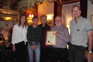 Melton CAMRA chairman Kevin Billson (right) presenting the award to landlords Jeff and Carol Evans and their daughters Lynn and Claire at a special celebration evening attended by a large group of members and some of the pub's locals PHOTO: Supplied