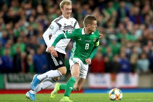 Northern Ireland captain Steven Davis  with Germany's Julian Brandt during the European Championship qualifier in Belfast. Pic by PressEye Ltd.