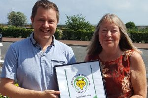 Anne receives her gift from Leicestershire and Rutland County FA business development officer Jamie Clarke EMN-191009-153417002