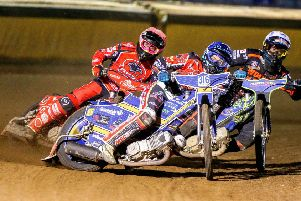 Ulrich Ostergaard (centre) and Scott Nicholls lead Panthers to a crucial 5-1 in the final heat against Wolverhampton. Photo: Jeff Davies.