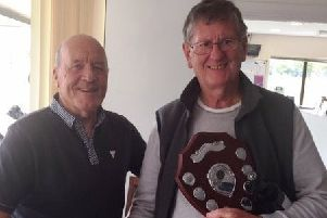 From left, Paul Whiter presents Edward Theobald with the Vic Allen Charity Shield at Little Hay Golf Club after his card play-off victory last Tuesday.