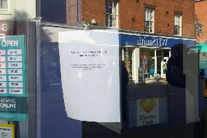 A notice on the door of the Thomas Cook shop in Melton announcing it is closed EMN-190923-120618001