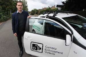 Councillor Blake Pain with the camera enforcement vehicle being used by Leicestershire County Council to clamp down on motorists who park irresponsibly outside schools EMN-190924-160519001