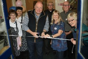 Radio Leicester's Ben Jackson cuts the ribbon with centre manager Linda Abbott at the Mary's Place relaunch EMN-190925-113826001
