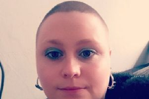 Rebecca Spivey pictured after having her head shaved EMN-190310-133336001