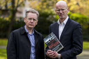 Dermot Lavery (left) and Michael Hewitt of Doubleband Films who directed, Lost Lives, a cinematic film inspired by the book of the same name, which was written over seven years by five journalists, that records the circumstances of every single death in the Troubles. PA Photo: Liam McBurney/PA Wire
