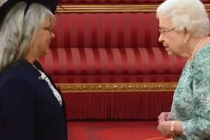 Judith Harper receives her MBE from HM The Queen