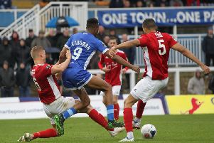 Brackley Town skipper Gaz Dean and Thierry Audel combined to thwart Hartlepool United striker Nicke Kabamba duirng Saturday's FA Cup tie. Photo: Mark Fletcher