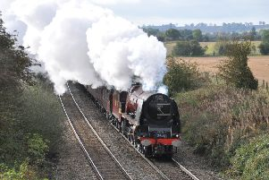 A steam hauled express train hauled by former LMS pacific 6233 Duchess of Sutherland pictured between Langham and Ashwell as it powered its way to Melton staion en route to York'PHOTO PAUL DAVIES EMN-191022-101059001