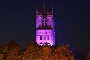 St Mary's Church in Melton is lit up purple to mark World Polio Day'PHOTO: Jonny McGrady NEMM EMN-191030-090655001
