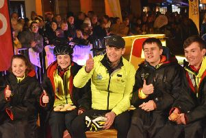Matt Baker and team members pose for the cameras after completing leg six from Matlock Bath to Melton EMN-191114-111808001