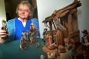 Organiser Margaret Phillips with Jill Upstone's scene using Austrian figures PHOTO: Tim Williams