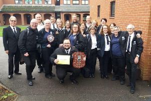 Members of The Melton Band celebrate being named 'best fourth section band' at the annual Leicestershire Brass Bands Association annual competition EMN-190912-125947001