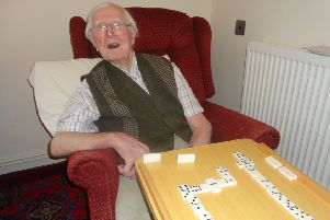 Ben Harley, who is celebrating his 100th birthday, enjoys a game of dominoes at Waltham Hall Nursing Home EMN-191213-170307001