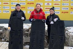 Amelia Coltman (centre) after winning gold in just her second international race EMN-191216-171213002