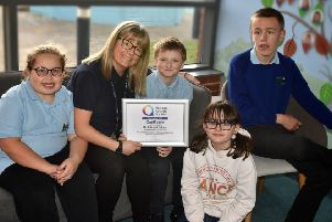 Assistant head and autism lead Amy Dunstan with pupils and their accreditation certificate at Birch Wood School EMN-191220-100712001