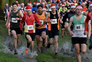The Gaddesby Gallop field are quick to get their feet wet as they pour away from the start line EMN-191223-124820002