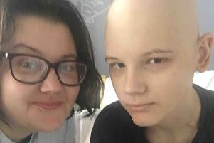 Charlie Hull, who has a rare form of cancer, with his mum Sam Smith EMN-200130-182216001