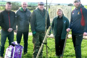 Memorial garden designer David Greaves, chair of Friends Of The Tenth, Alec Wilson, and Highground's Andy Wright  and Jane Taylor at the planting at the memorial to the 10th Battalion, The Parachute Regiment EMN-200226-135950001