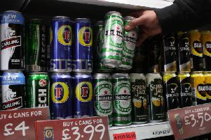 Supermarkets can challenge you for ID if they think you are younger than 25. Picture: David Cheskin/PA Wire