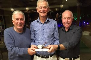 Hunston Trophy winner Jim Robertson, centre, with his closest rivals for the trophy