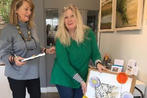 Karen Ongley-Snook (in green) delivering artwork to gallery assistant Lisa Kingwell