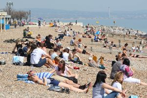 Beach-goers enjoying the sun in Worthing