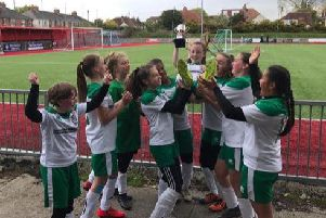The under-12 girls with the cup