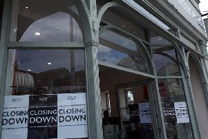 Closing down signs in the window of Steamer Trading in Cornfield Road, Eastbourne