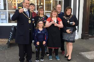 """Cafe Track staff with paralympic gold medallist Ellie"""" Robinson MBE and the former Mayor and Mayoress of Northampton."""