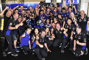 Mavereck Vinales celebrates his Assen victory with his Monster Yamaha team.