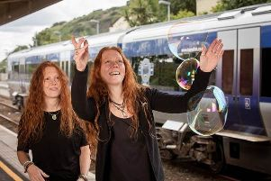 Whitehead Food and Folk Festival has teamed up with Translink to encourage visitors to take advantage of summer travel discounts. Demonstrating some of the attractions are the festival's Karen and Claire Gibson.