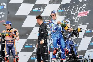Alex Rins celebrates winning the GoPro British GP with Marc Marquez. Picture: Maurice Montgomery.