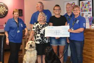 Members of the Boston fundraising group of Guide Dogs for the Blind was presented with the money by Fairfield Guest House. Also pictured are guide dogs Orson and Orlando. Image supplied.