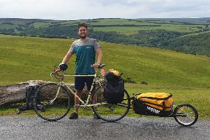 Lewis Stephens with his 60-year-old Claud Butler bike and trailer