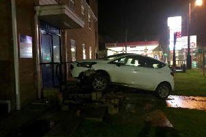 A car collided with railings and a disabled ramp at the entrance to the police stationonA286 Bepton Road. Photo: Phil Bowell
