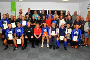 The team members with their certificates