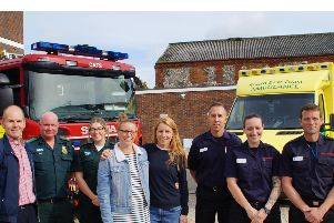 (Left to right) Simon Rowles with ambulance technician Gary Weller, paramedic Ellie Toombs, Katie Rowles, Carrie Hill, Ben Goodridge,  Daniella Hodge, Matt Simmons and watch commander Suzanne Goff. Photo: West Sussex Fire and Rescue Service