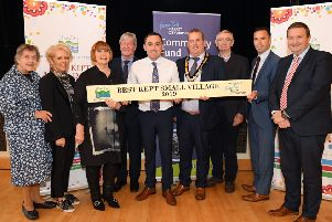 Pictured accepting the Best Kept Small Village award for Castlecaulfield village are, (l-r): Doreen Muskett, MBE; Rosemary McGirr; Bernie McKenna; Joe Mahon; Bob McClure; Deputy Chair of Mid Ulster District Council, Councillor Clement Cuthbertson; Pat McGirr; Eunan Murray and Stephen Patton.
