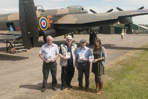Set for the release of NX611 ' The Flying Years, (from left) HAPS members Alan Bridges and Richard Taylor, Just Jane owner Harold Panton, and Primetime Video DVD producer Joanna White.
