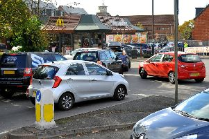 Traffic queueing to enter McDonalds drive thru Burgess Hill is causing problems on the roundabout just outside. Pic Steve Robards SR1829128 SUS-180311-162546001